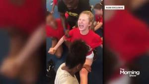 Police investigate video of cheerleader being forced to do the splits