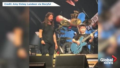 This kid playing with the Foo Fighters looks like Angus Young.
