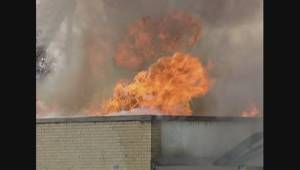 Archival footage of East Elmwood Comunity Centre burning to the ground four years ago