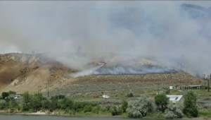 Crews battle a rapidly moving wildfire in east Kamloops