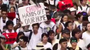 Hong Kong protesters take message closer to China