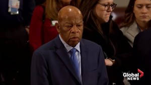 Civil rights leader John Lewis pays his respects to President George H.W. Bush