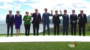 G7 leaders take traditional 'family photo' group shot