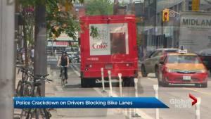 Toronto parking enforcement cracks down on drivers blocking bike lanes (02:15)