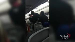 Air Canada cabin arrest caught on camera after passenger allegedly threatened to open door