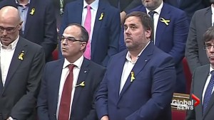 The moment: Catalonia parliament votes overwhelmingly for independence from Spain