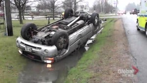 Woman injured after pickup truck flips, lands in ditch in Cobourg