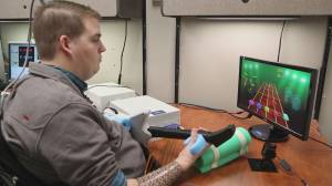 Brain chip implant helps paralyzed man regain control of hand