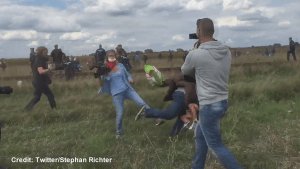 Photojournalist caught on camera tripping and kicking fleeing refugees in Hungary