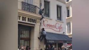 As fire rages in Marseille apartment, children lowered from balcony with help of passers-by