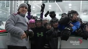 Elvis Stojko skates with students in Ennismore