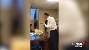 Mitt Romney celebrates birthday by awkwardly blowing out candles on Twinkie cake