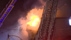 Firefighters battle 3-alarm townhouse fire in Corktown