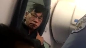 'I have to go home': videos show United Airlines passenger bloodied after removal