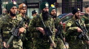 Canadian soldiers carry guns at 2019 Toronto Khalsa Day Parade