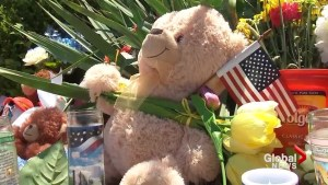 Mourners set up makeshift memorial at duck boat business in memory of 17 people who died