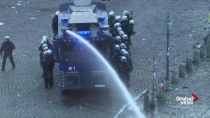 Police use water cannons on G20 protesters in Hamburg, Germany
