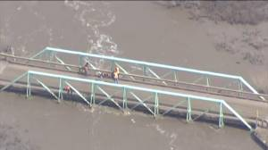 Global1 footage shows waters dangerously close to bridge in Wayne, Alberta