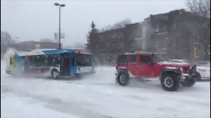 Good Samaritans help tow Montreal bus stuck on slippery slope