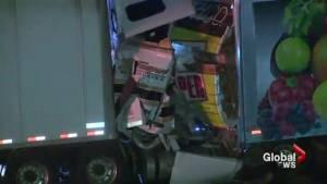 Driver killed after transport trucks collide on Hwy 401