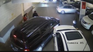 Security footage released by ICBC shows man allegedly faking parking lot injury