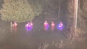 Crews searching Grand River after woman pulled out of water