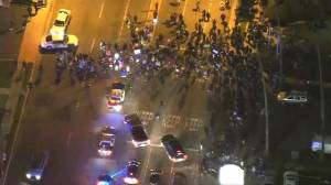 Hundreds protest in Los Angeles overnight after off-duty officer fires weapon at teenager