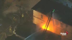 Fire fighters battle 10 alarm fire in Cambridge, MA