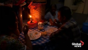 Indian flood-hit family eats by candlelight amid week-long blackout