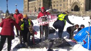 Truck convoy members chant 'Trudeau for treason'