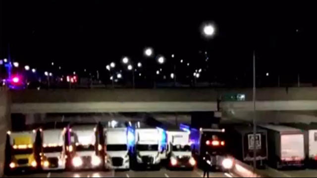 13 semitrucks join forces to help save suicidal man on Detroit freeway