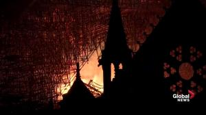 Notre Dame fire: Flames rage inside cathedral as darkness falls