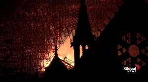 Notre Dame fire: Flames rage inside cathedral as darkness falls (01:02)