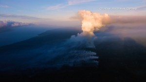 Video shows Hawaii's Kilauea volcano still spewing smoke, lava and flames
