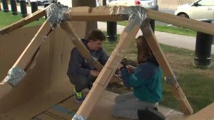 Teams camp out under cardboard in Fredericton to support homeless youth