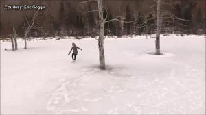 Canadian figure skater goes skating over beautiful frozen lake in New Brunswick