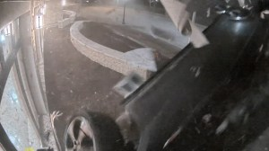 Illinois man arrested after video shows car being driven at high speed into police station