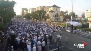 Indonesian Muslims pray to start Eid al-Fitr