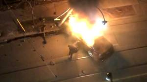 Toronto police braved burning car to attempt rescue, but passengers fled