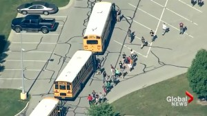 U.S. school children evacuate on buses after reported shooting