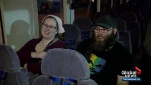 Some of the last STC riders to Saskatoon stage rally on the bus late into the night