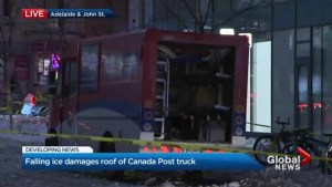 Canada Post worker narrowly avoids being struck by falling ice from Toronto condo