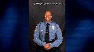 Police officer fatally shot in Georgia near school, suspects ran away, authorities say
