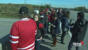 Canadians gather along the Highway of Heroes