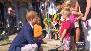 Prince Harry greets spectators outside Toronto's CAMH building