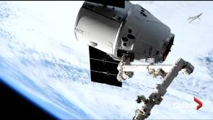 SpaceX Dragon cargo craft arrives at ISS with help of Canadian-made robotic arm