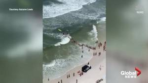 'Human chain' formed to rescue stranded swimmer