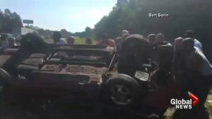 Rescuers help save convertible driver after dramatic rollover (00:44)