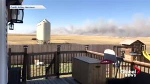 Video shows smoke from wildfire that sparked emergency alert in Alberta