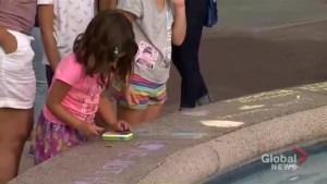 Memorial grows at fountain near Danforth shooting scene